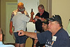 JR08: Up by the door – Bill Burley with beer bottle talking to Duff Rawlings (hidden behind Bill) and Brian Keelan, drop down to Joe DeFrank in cap and glasses (Joe was with B Co and was WIA at Lo Giang) and Don Kaiser (our world traveler who has been to Vietnam twice in the last year)