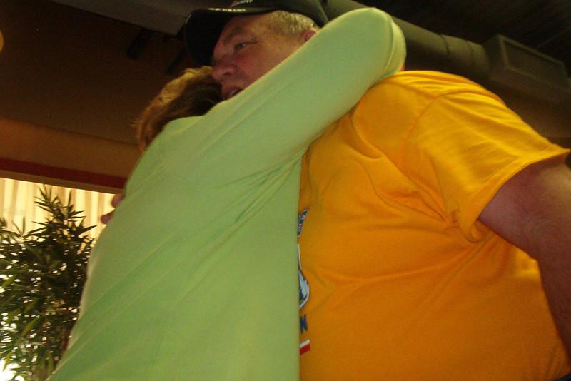 Terri Buelow hugs Don Kaiser (3rd Plt, TX)