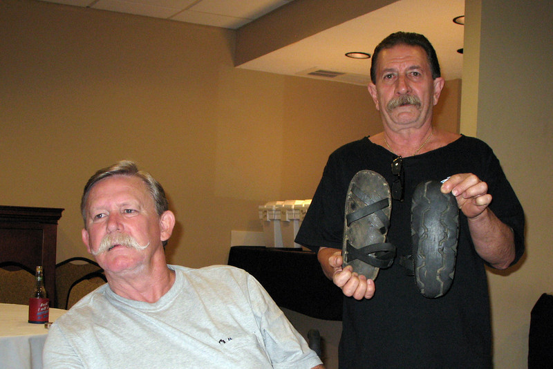 JR05: Alan Allen and Jerry Baynes.  Jerry still has some VC sandals made from old tires.  Put your mouse cursor over photo and select X2 or Original from the drop down box to zoom in for a good look at the sandals.