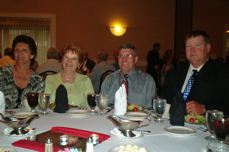 JR41: Debbie Moles, Sue Jane Brewer, Bob Moles, and Jim Brewer, enjoy the Americal Banquet.