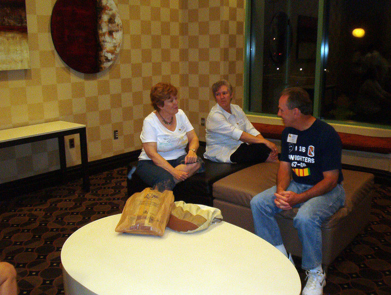 BCR-011 Sue Jane Brewer, Loretta Armand, and Larry Watson enjoy conversation.
