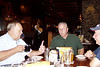 CR030: Wisely, Frank Kelly, center, looks askance at another one of Don Kaiser's tales, while Gary LaRussa looks on from the right.