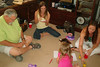 TX-11-MINI-53: Harry Thompson, Maggie Allen (Allen's daughter), Shauna Allen (daughter-in-law), and grandaughter Riley Allen, play in the middle of the floor during the June 2011 mini-reunion.