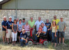 """TX-11-MINI-39: John Carlson, Larry and Cindy Boetsch, Terry and Terri Buelow, Thomas """"Frenchy"""" and Tessie Charbonneau, Harry Thompson, Don Kaiser, Joe Gamache, Maggie Allen, Nathan Allen, and Brian Perkins. Bill Wendover is hunkered down, and Riley and Alan """"Paw Paw"""" Allen are on the electric scooter. All in Texas for the June 2011 mini-reunion."""