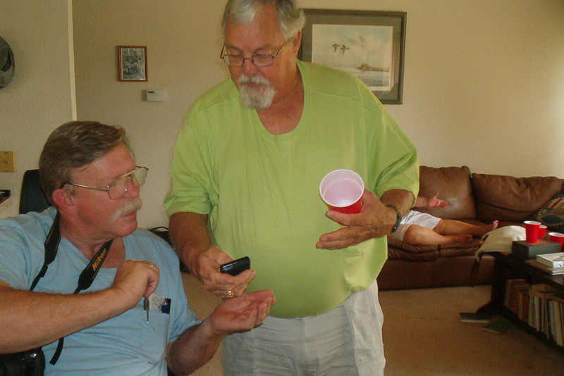 TX-11-MINI-68: Texans Harry Thompson explains something complex to Alan Allen during the June 2011 mini-reunion.