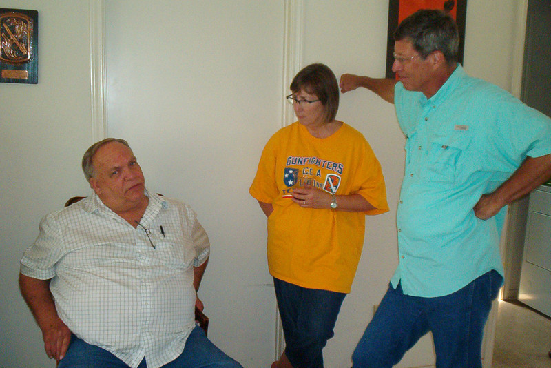 TX-11-MINI-64: Don Kaiser tells Judy Johnson (Allen's sister) and her husband, Jeff, a tall tale during the June 2011 mini-reunion.
