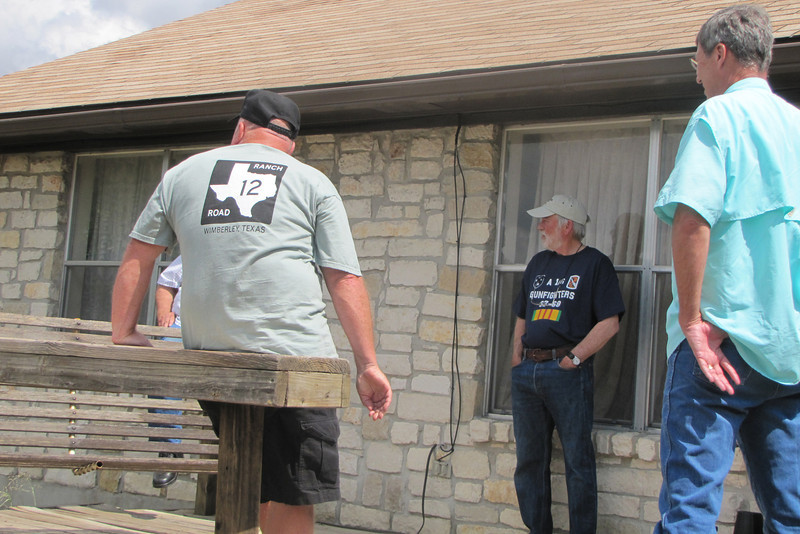 TX-11-MINI-07: Frenchy Charbonneau, Bill Wendover, and Jeff Johnson chat on the deck during the Texas June 2011 mini.