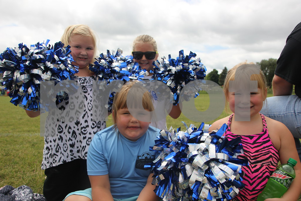 "Pictured here are Back Row (left to right): Avah Olicht, and Lucy Midtling, <br /> Front Row (left to right): Payten Olicht, and Madysen Olicht cheering the Police team on. The event called ""Guns and Hoses"" was held on Sunday, August 9, 2015 at Fort Frenzy in Fort Dodge and was between Fort Dodge Police officers and Fort Dodge Firefighters."