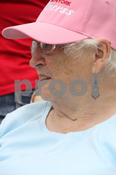 "Dorothy Solverson  watches  the  ""Guns and Hoses"" football game held at  Fort Frenzy in Fort Dodge on Sunday, August  9, 2015. The teams were comprised of  officers from the Fort Dodge Police Department and the Firefighters from the Fort Dodge Fire Department."