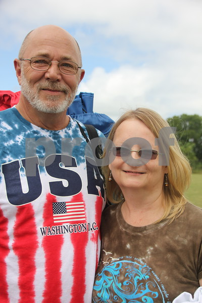 """Dan Buenting and Vicki Kraus enjoy  the"""" Guns and Hoses"""" football game that took place at Fort Frenzy in Fort Dodge, on Sunday, August 9, 2015. The game is the first event of its kind in Fort Dodge and it is hoped to become an annual event. The teams were comprised of  officers from the Fort Dodge Police  Department and  Firefighters from the Fort Dodge Fire Department."""