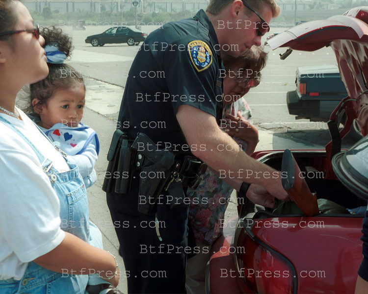 Saturday,March 31,2001 in San Diego. The Santana Shooting devasted San Diego Community.Just weeks later another school shooting in  El Cjon,prving guns in the wrong hands lead to deadly consequences.Today was a chance offers to the public to dispose of their unwanted guns.It,s also an opportunity to meet parents whose children have been victims of gun violence.The sponsors of this day is Team 10 ( San Diego's 10 KGTV )and the San Diego Police Department as they dispose of your unwanted guns and in return they give tickets to the hot San Diego Gulls Playoff Games at the San Diego Sports Arena .Also , Win prizes from the San Diego State Aztecs,Coca Cola,Wendy's and Pizza Hut. Total of the day 140 weapons . (photo by Michel Boutefeu)