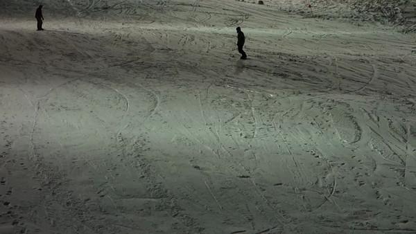 Terry snowboarding at night at Boreal.