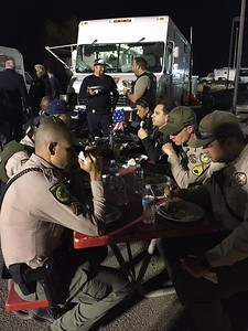 Butte County Sheriff's Office personnel enjoy a meal from Guy Fieri, who is helping feed folks who working amid the Camp Fire. (Butte County Sheriff's Office -- Contributed)