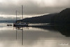 Island Roamer reflected in Morseby Camp harbour, Morseby Island, Haida Gwaii