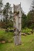 Weathered old mortuary pole with small face, S'Gaang Gwaii, Haida Gwaai, BC