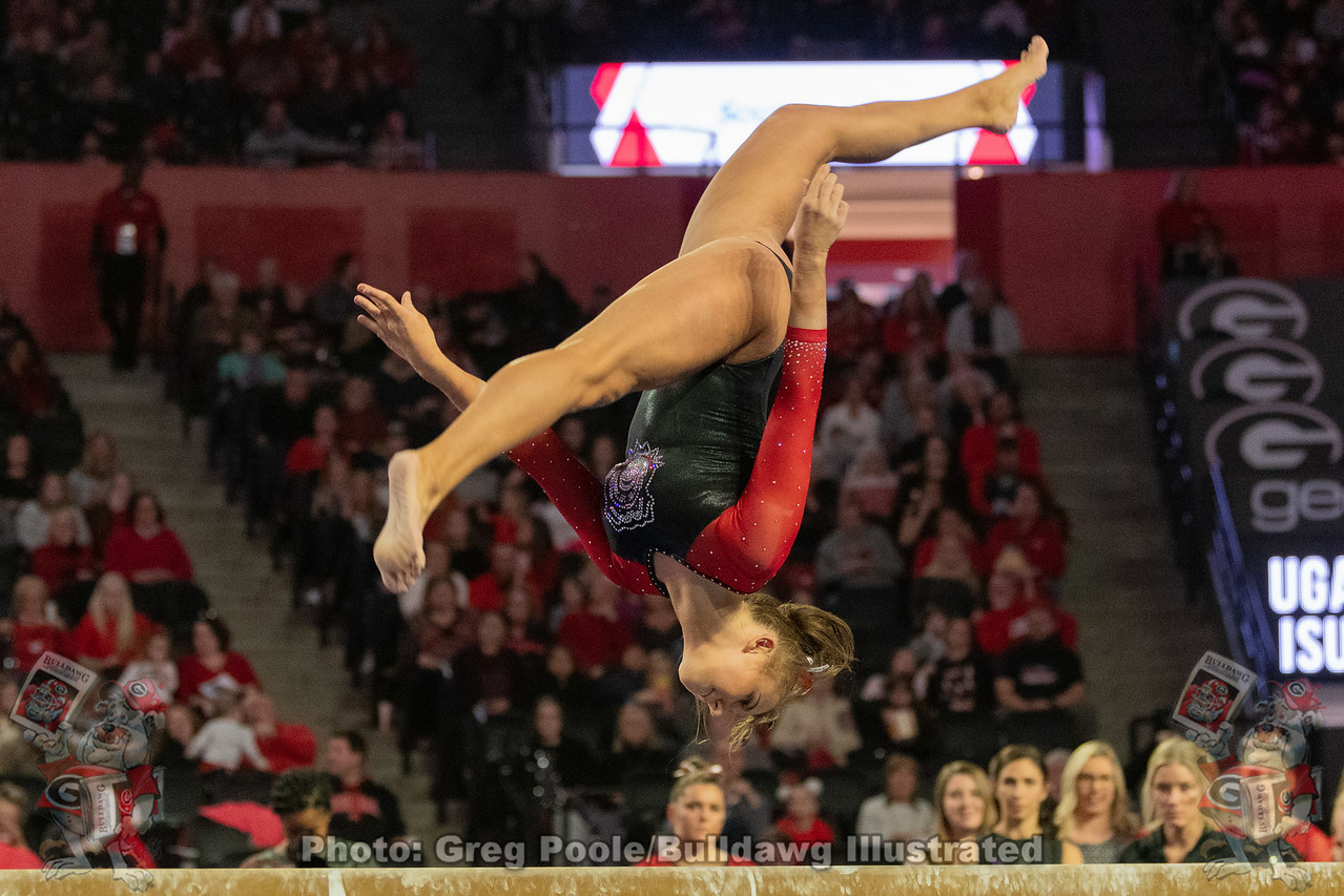 Haley De Jong performs her routine on the beam during the Martin Luther King, Jr. Day meet on Monday, January 20, 2020 in Athens at Stegeman Coliseum.