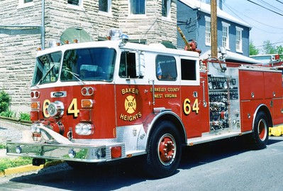 Former Engine 64, a 1978 Seagrave PB/1987 Pierce, 1500/500.  ex - Fairfax City, Virginia.  Donated to a department in Fentress County, Tennessee, in approximately 2000.