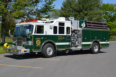 "Romney, West Virginia (Hampshire County) placed into service their ""new"" Engine-Rescue 1 in 2016.  Purchased from the Upper Makefield Fire Company in Washington Crossing, PA (where it ran as Rescue 71), this 1995 Pierce Lance is equipped with a 1750/500/40B and job number E8764.  Romney's other apparatus is either red or red and white.  The FD is keeping the green and white colors since the Hampshire High School Trojans have these colors.  The slogan ""Protecting The House Of Troy"" on the front is in reference to the high school's gymnasium."