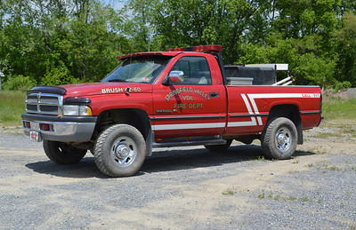 Two brush trucks at Springfield Valley.  Brush 42-60 is a 1995 Dodge Ram 2500 with a 200 gallon water tank.