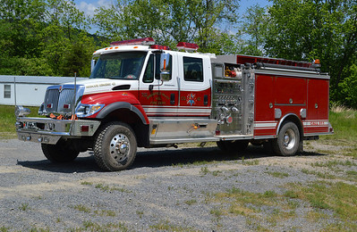 Rescue Engine 42 is this nice 2006 International 7400 4x4/Crimson, 1000/750, sn- 6057.