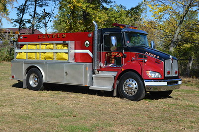 The officers side of Tanker 6, a 2011 Kenworth T370/Crimson 500/2000.