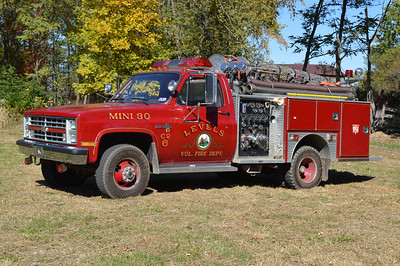 "The old radio designation of Attack 6 from Levels is still on the truck, showing the unique history of the county numbering system.  At one time in Hampshire County, units with a number between ""11-19"" were engines, ""20-29"" were tankers, and ""30"" was a mini pumper.  In the past, this 1988 Chevrolet Scottsdale 30/American Eagle was once ""6-30"", and today it is referred to as Attack 6.  Equipped with a 500/250 and serial number C1190.  Photographed in October of 2015 behind the fire station."
