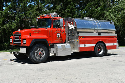 Moorefield's Tanker 46 originally had a 1983 Ford L chassis.  In 1991, a Mack RD688P was joined to the 1983 4-Guys body.  Assigned 4-Guys serial number F592, it has a 500 gpm pump and carries 2000 gallons of water.  This photograph was taken in June of 2017, shortly before it was replaced in Moorefield by a new tanker.  Because the new tanker was purchased through grant money, the Mack can no longer be used in firefighting service.
