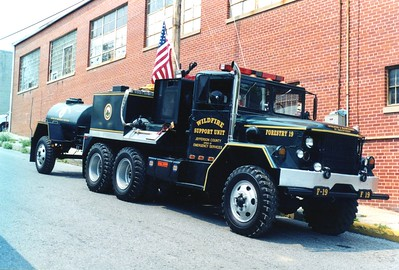 Jefferson County's former Forestry 19, a 1967 Kaiser/2000 FD, 300/800.  Photographed towing a 375 gwt trailer.  Equipment from the 1962 Kaiser was used in this truck.