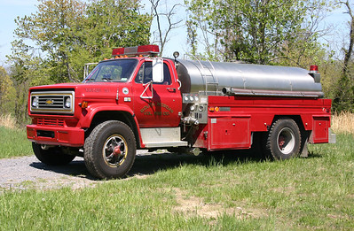 Tanker 3-21, a 1986 Chevrolet C70/1985 4-Guys/1990 4-Guys  500/1800.  The 1985 rehab was for an old tanker body.  The 1990 rehab included a new 500 gpm pump.  South Morgan, WV.  As of March of 2018, this unit is still in service.