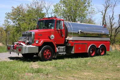 Tanker 3-25 from South Morgan, WV, a large 1990 AutoCar WCM-64/4-Guys 1000/4000 and serial number F1199.