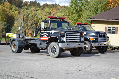 Two utility trucks found at Bradley-Prosperity.
