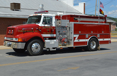 Pumper/Tanker 494 from Petersburg is this 1998 International 2674 that was built by KME.  It is equipped with a 1250/1500 and KME GSO number 3631.