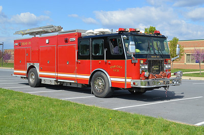 Star City, West Virginia Squad 203 - 1997 E-one Cyclone II 1500/500 with serial number 17512.  Ex - Naperville, IL Squad 8.  Star City received in 2013.  Photographed at the 2014 Apple Blossom.