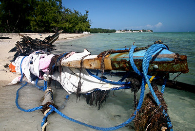 These Are Remains Of A Boat That Was Used By Haitians To Illegally Sail To The Bahamas Directly From Haiti. It Was Burned By Bahamians Soon After It Came Ashore.