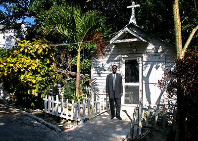 Pastor Basil In Front Of The Camp's Church.