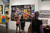 Patrons examine art at ArtHamptons at Nova's Ark in Watermill.(July 13, 2012)<br /> photo by Rob Rich/SocietyAllure.com