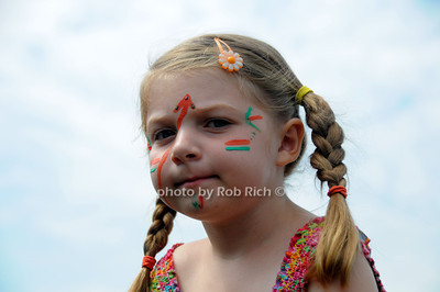 Face painted child enjoys  the 66th.Annual Shinnecock Pow Wow at the Shinnecock Indian Reservation in Southampton. (Septemeber 3, 2012) photo credit: Rob Rich/SocietyAllure.com