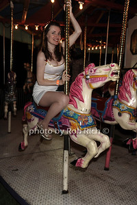 """Riding the carousel at Sir Ivan's release party for his new single and video """"La La Land"""" at the Sir Ivan's Castle in Water Mill.(August 18, 2012) photo credit: Rob Rich/SocietyAllure.com"""