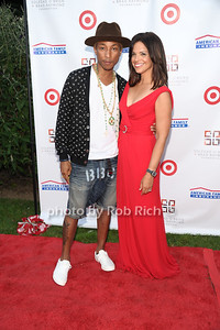 Pharrell Williams and Soledad O'Brien attend the  Hamptons fundraiser for Soledad O'Brien & Brad Raymond Foundation at a private residence in Bridgehampton (July 27, 2012). Rob Rich/SocietyAllure.com