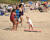 Learning surfing at an early age at the beach in  Ditch Plains in Montauk on September 16, 2012.<br /> photo credit: Rob Ricch\SocietyAllure.com