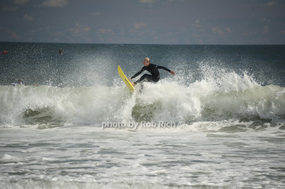 Taking to the waves at the beach in  Ditch Plains in Montauk on September 16, 2012. photo credit: Rob Ricch\SocietyAllure.com