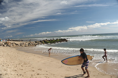 Finishing a day of surfing at the beach in  Ditch Plains in Montauk on September 16, 2012. photo credit: Rob Ricch\SocietyAllure.com