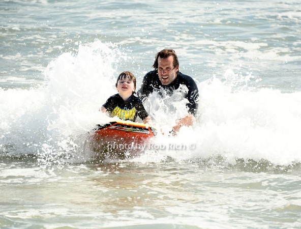Boogie Boarding with Dad at the beach in  Ditch Plains in Montauk on September 16, 2012.<br /> photo credit: Rob Ricch\SocietyAllure.com
