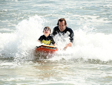 Boogie Boarding with Dad at the beach in  Ditch Plains in Montauk on September 16, 2012. photo credit: Rob Ricch\SocietyAllure.com