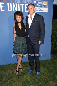Alina Cho and John Demsey attend the United Way's fundraiser at the Southampton residence of Avis and Bruce Richards. (August 25, 2012) photo credit: Rob Rich/SocietyAllure.com