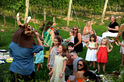 Children ejoy a performer from A Midsummers Night Dream at the Wolffer Estate Vineyard'sTwilight Thursday in Sagaponack. (August 9, 2012) photo credit:Rob Rich/SocietyAllure.com