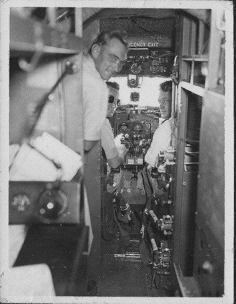 "Dad. FltLt John ""Jack"" Watson Finlay navigator, RAAF. Here ina Dakota sitting in the wireless operator's position I think as it is further forward than the nav's seat in the HARS aircraft."