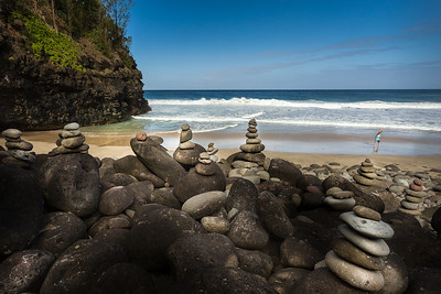 Hanakapiai beach 2 miles in on Kalalau trail. The Rocks are called ahu in Hawaiian but Hawaiians don't put them there. In fact stones in Hawaiian are sacred and they really don't like them stacked...but tourist think they it's cool