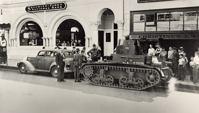 USA Military tank in front of Security First National Bank, c 1940s. #1990.037.005.