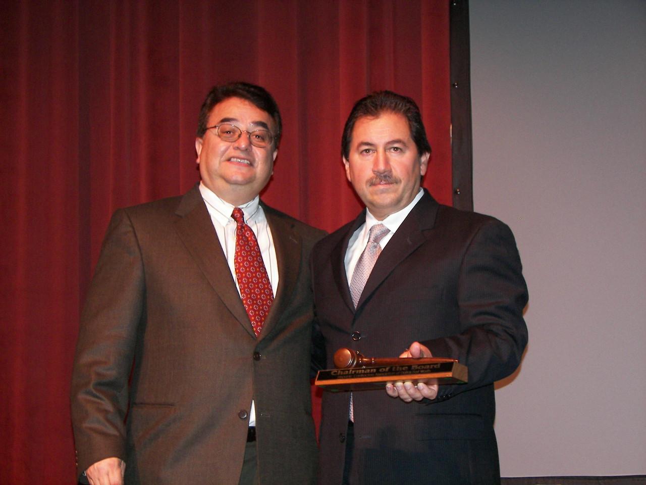 Chris Escobedo presents Luis Spinola with a commemorative gavel.